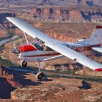 A Cessna 185 flying over the Green River near Moab, Utah